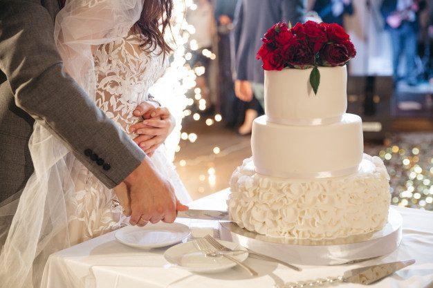 happy-bride-groom-cut-wedding-cake_8353-9297.jpg