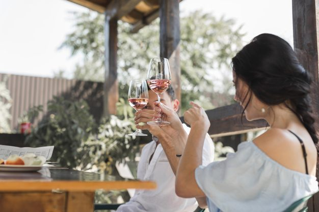 young-couple-toasting-wine-glasses-garden_23-2147923042.jpg